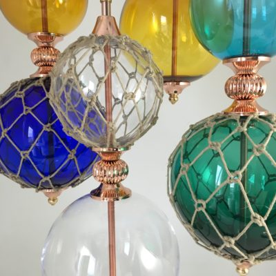 Photo of Glass and Macrame ball light features made by Rothschild & Bickers for Ted Baker…
