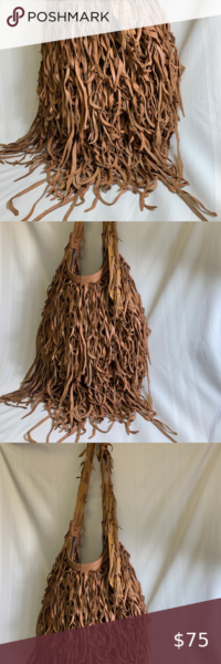 Photo of Handbag made of leather straps Long strap to hang around shoulders. Made all of …